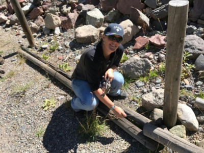 ouray hot springs OHSP Employee Sherri working on the fence line along the Riverwalk.